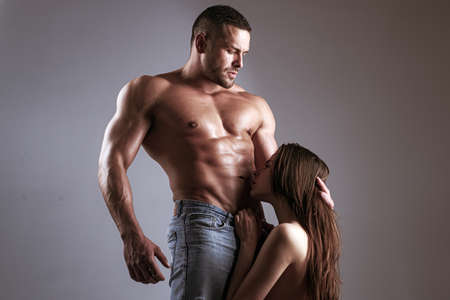 Photo pour Sensual couple kiss. Couple In Love. Romantic and love concept. Hugs together and sensual touch. Sexually explicit. Passionate lover caressing arousing beautiful woman. Dominant man. Loving people. - image libre de droit