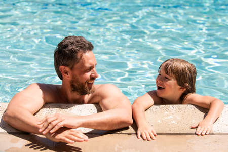 Photo pour Portrait of father and son relax in swimming pool. Pool resort. Happy family face. Copy space. - image libre de droit