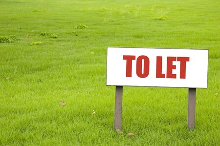 Shot of a to Let board on green grass