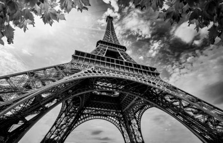 Photo pour Eiffel Tower in Paris France. Eifel Tower with Golden Light Rays and Beautiful Architecture. Black and White Photography - image libre de droit