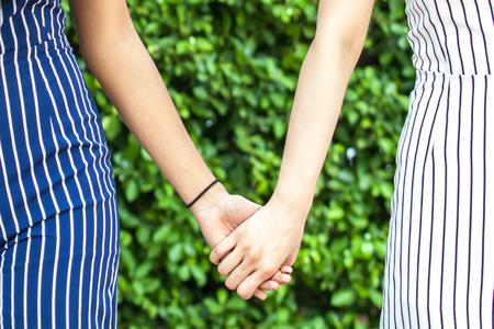 Photo pour Female best friend forever holding hands together - friendship and love concept - image libre de droit