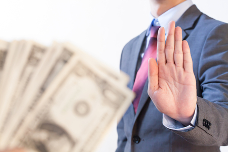 Businessman refuses to receive money - no bribery and corruption concept