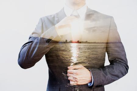 Photo pour Double Exposure of businessman in offshore sunset sea background - image libre de droit