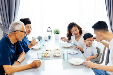 Photo pour Happy Asian extended family having dinner at home full of laughter and happiness - image libre de droit