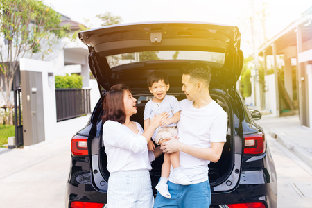 Photo for Happy Asian family standing on the back of SUV car with smile and happiness - Royalty Free Image