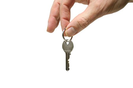 hand holding a key isolated on white background