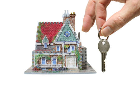 house with hand and keys isolated on white background