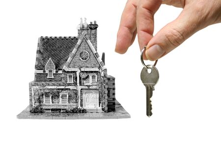 a new house with hand and key
