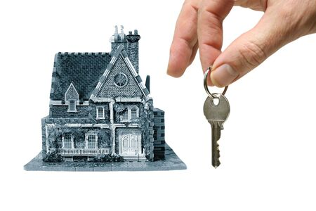 house with hand and key