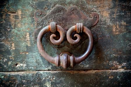 antique door-knocker on old door with beautifull texture