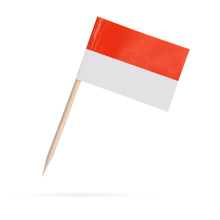 Miniature paper flag Indonesia. Isolated Indonesian Flag on white background.With shadow below