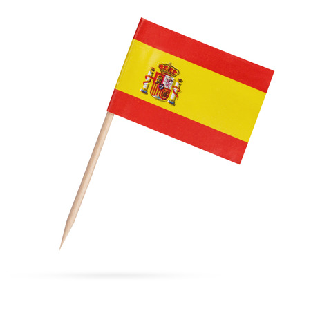 Miniature paper flag Spain. Isolated Spanish Flag on white background.With shadow below
