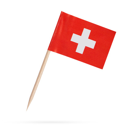 Miniature paper flag Switzerland. Swiss Flag Isolated on white background. With shadow below