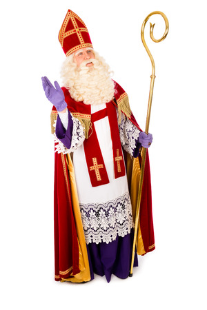 Sinterklaas waving portrait full length . isolated on white background. Dutch character of Santa Claus
