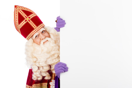 Sinterklaas with white cardboard. isolated on white background. Dutch character of Santa Clausの写真素材