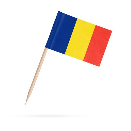 Photo pour Miniature paper flag Romania. Isolated Romanian toothpick flag pointer on white background. With shadow below - image libre de droit