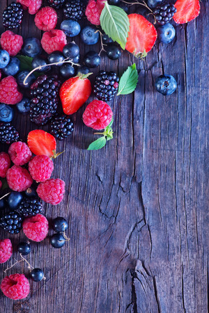 Photo for berries on the wooden table, mixed berries - Royalty Free Image