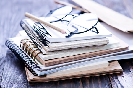 Stack of spiral notebooks on a table
