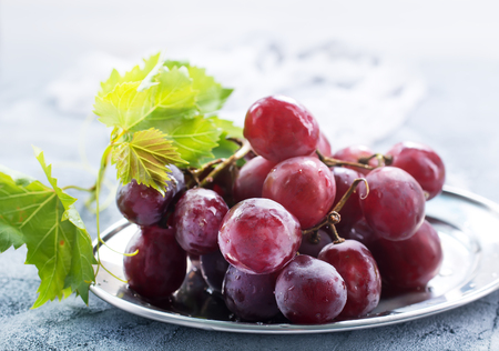 Photo for fresh grape on plate and on a table - Royalty Free Image