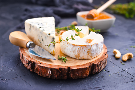 Various types of cheese, blue cheese and brie with honey and nutsの写真素材