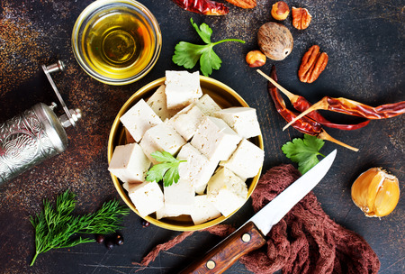 Photo pour tofu cheese in metal bowl on a table - image libre de droit