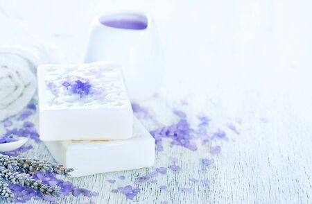 Foto de spa objects, lavender soap and towel on a table - Imagen libre de derechos