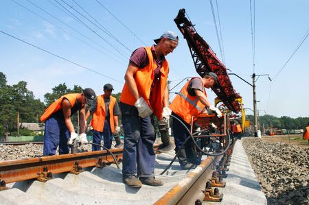 KYIV REGION, UKRAINE - AUGUST 21: Repair workers modernize the 1, 000th km of Irpin-Bucha railway line on August 21, 2007  in Kyiv region, Ukraine