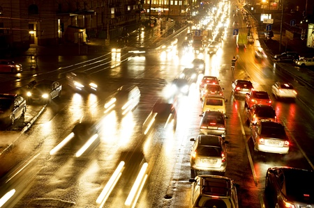 Kiev, Ukraine - January 11, 2011: Night traffic on Podol quay in Kiev