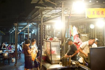 Kuala Lumpur, Malaysia - March 30, 2011: Street fast food in Kuala Lumpur's China Town at night.