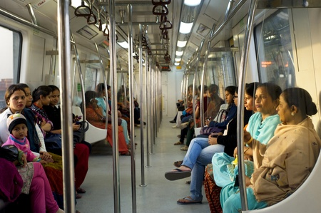 Delhi, India - February 03, 2012:  Women-Only Subway Cars  in Delhi. Delhi Metro network consists of six lines with a total length of 189.63 kilometres (117.83 mi) with 142 stations