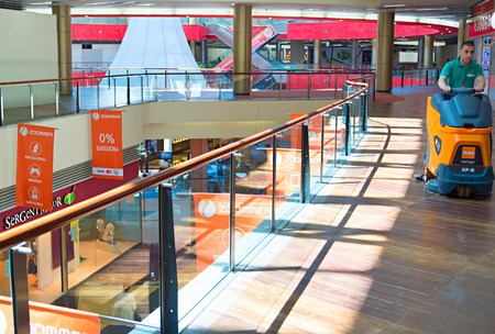 TBILISI, GEORGIA - MAY 05, 2015: Cleaning in progress in Tbilisi shopping mall.The Mall occupies a total of four floors with a GLA of approximately 74,000 square metres