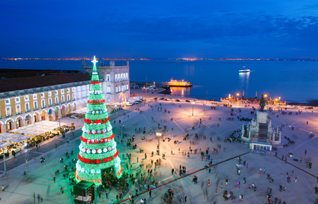Christmas tree on Commerce square at twilight in Lisbon, Portugal