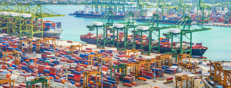 Photo for Aerial panorama of cargo ships in Singapore industrial port harbor by pier with freight cranes and goods containers, seacsape at background - Royalty Free Image