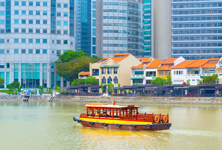 Photo for Tourist boat at Boat quay district in Singapore - Royalty Free Image