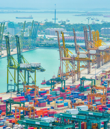 Photo for Aerial view of Singapore commercial port, stacks of shipping conteiners, freight cranes and cargo ships in harbor - Royalty Free Image