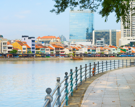 Photo for Colorful buildings of Boat Quay district and modern buildings facades view from Singapore embankment - Royalty Free Image