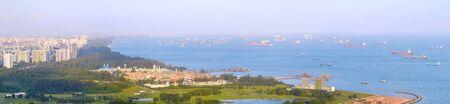 Foto de Panorama of Singapore harbor with many cargo ships at sunset. Singapore - Imagen libre de derechos