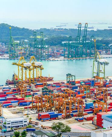 Photo for Aerial view of Singapore trade port, heavy equipment, cargo containers, freight cranes, docks and storages, harbor with ships and tankers - Royalty Free Image