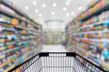 Photo pour Abstract blurred photo of store with trolley in department store bokeh background - image libre de droit