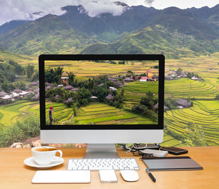 Photo for Conceptual image of a workspace with computer desktop on Traveler take picture at Rice fields on terraced of Tu le District, YenBai province, Northwest Vietnam - Royalty Free Image