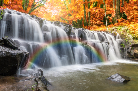 Beautiful waterfall in the forest with rainbow, Sam lan waterfall, Thailand