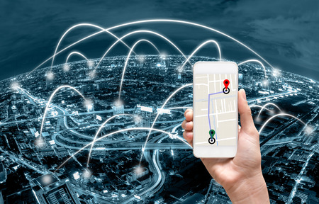 Photo pour female hands holding a smart phone showing part of navigator map over screen on Network connection line between building over the top view of cityscape background, Navigation concept - image libre de droit