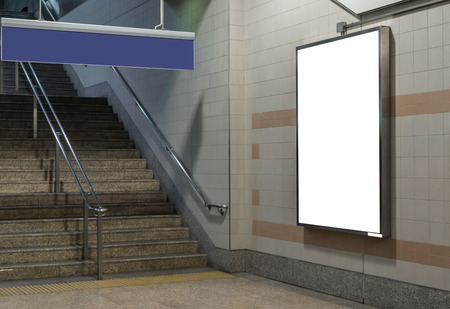 Photo pour Blank billboard located in underground hall or subway for advertising, mockup concept, Low light speed shutter - image libre de droit
