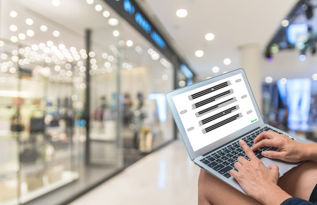 showing the chat message for Shopping Online With Digital laptop on Abstract blurred photo of department store bokeh background, technology and internet concept