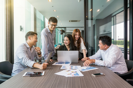 Foto de Group Of AsianBusiness people with casual suit working and brainstorming with happy action and celebrate in the modern Office, people business group concept - Imagen libre de derechos