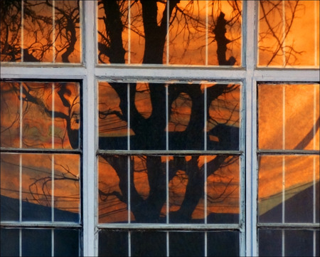sunset on reflection of window