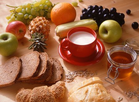 healthy food,dark bred,honey and fresh fruits.