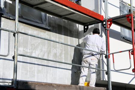 Photo pour Painting works, facade painting - image libre de droit
