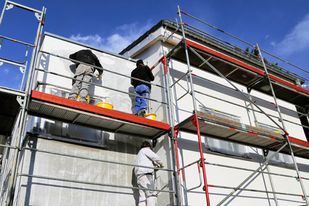 Photo pour Painting works, facade painting - image libre de droit