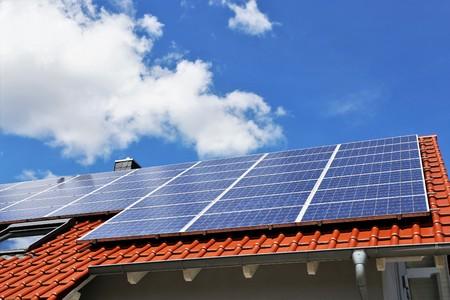 Photo pour Photovoltaic: Roof with solar panels - image libre de droit